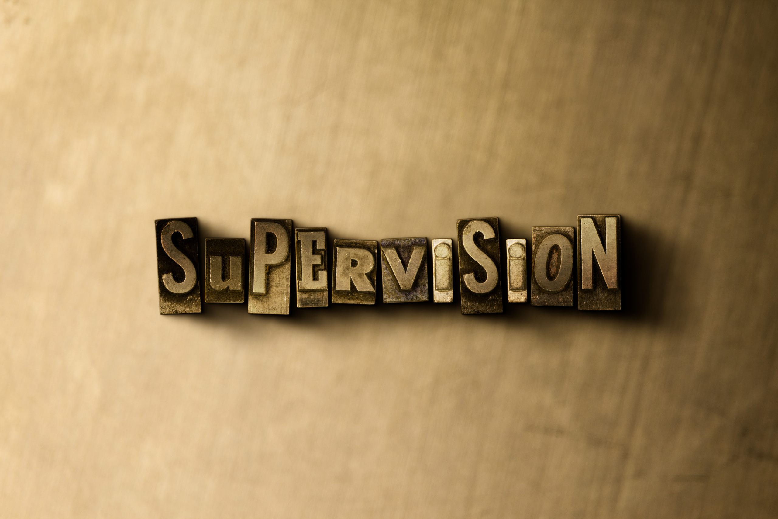 supervision-guld
